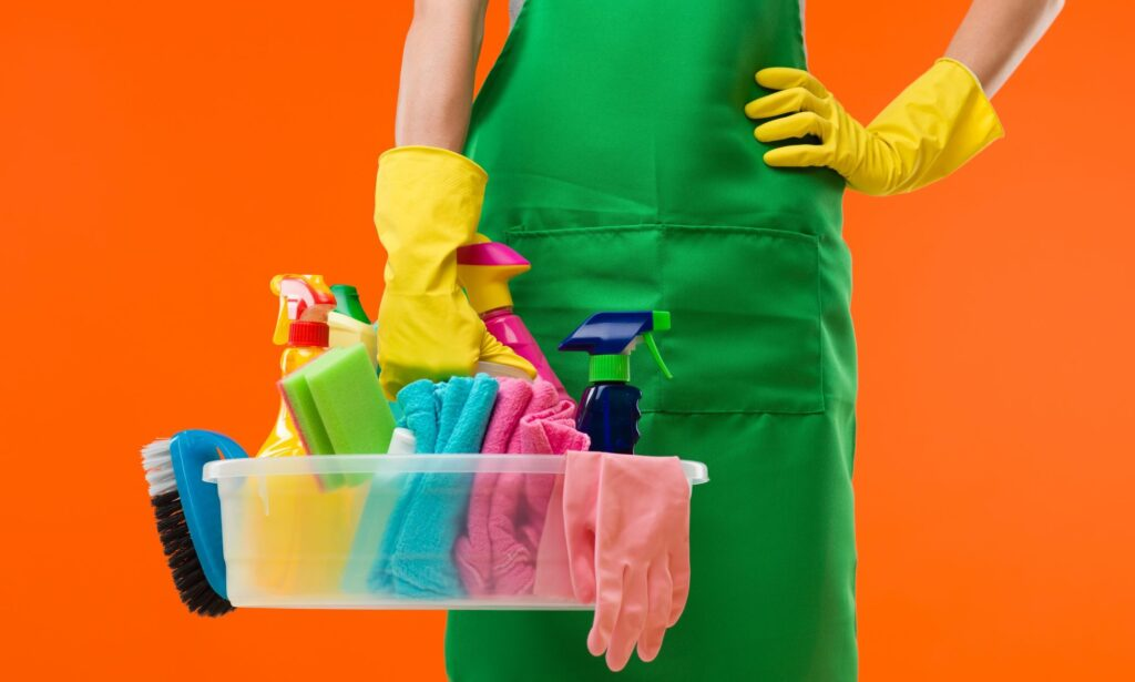 a photo of a cleaner with cleaning supplies