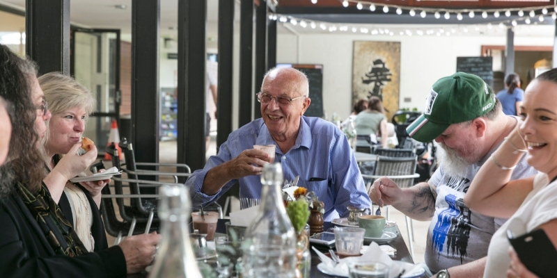 Tenants and Link Wentworth staff members talking at a restaurant