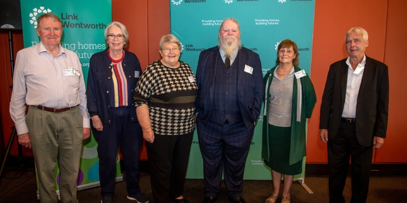 Tenant Advisory Group members from different regions smiling for the camera at NSW Parliament House